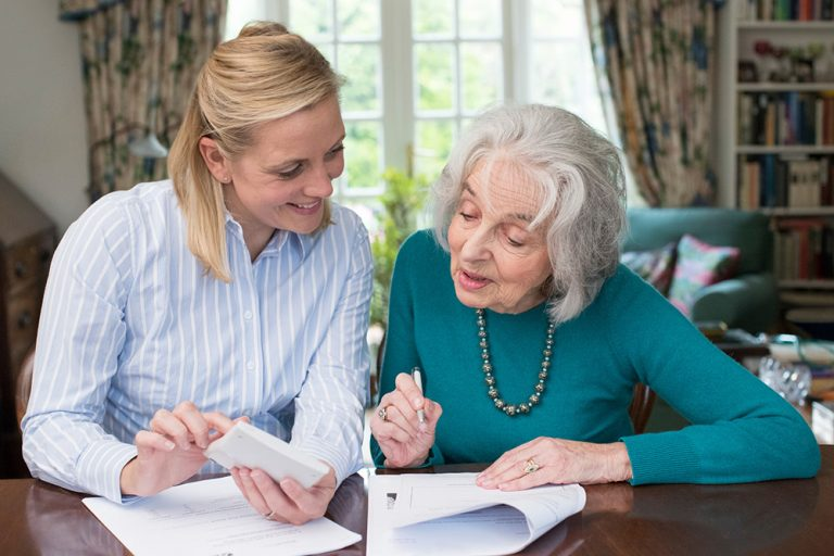 lady signing power of attorney-document